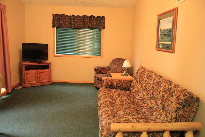 Cabin 4 living room | Nitti's Hunters Point Resort