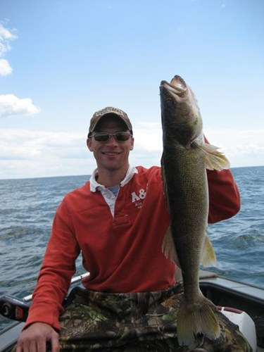 angler holding fish on mille lacs